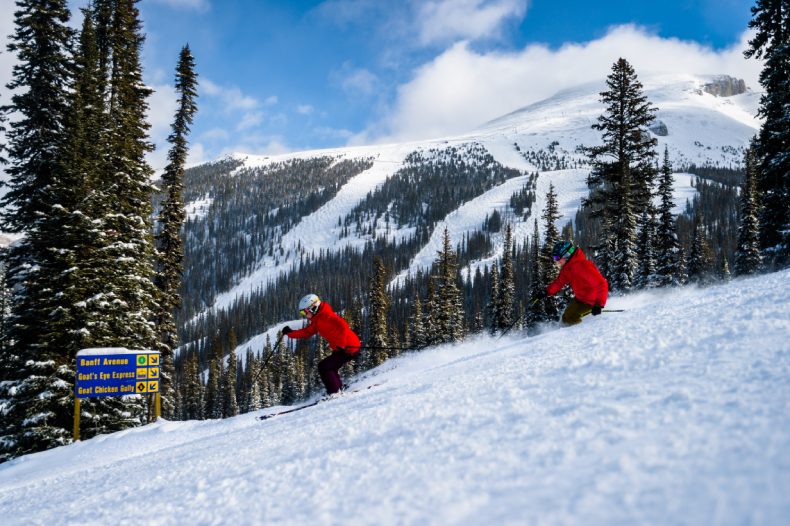 Two skiers Skiing Sunshine SkiBookings.com