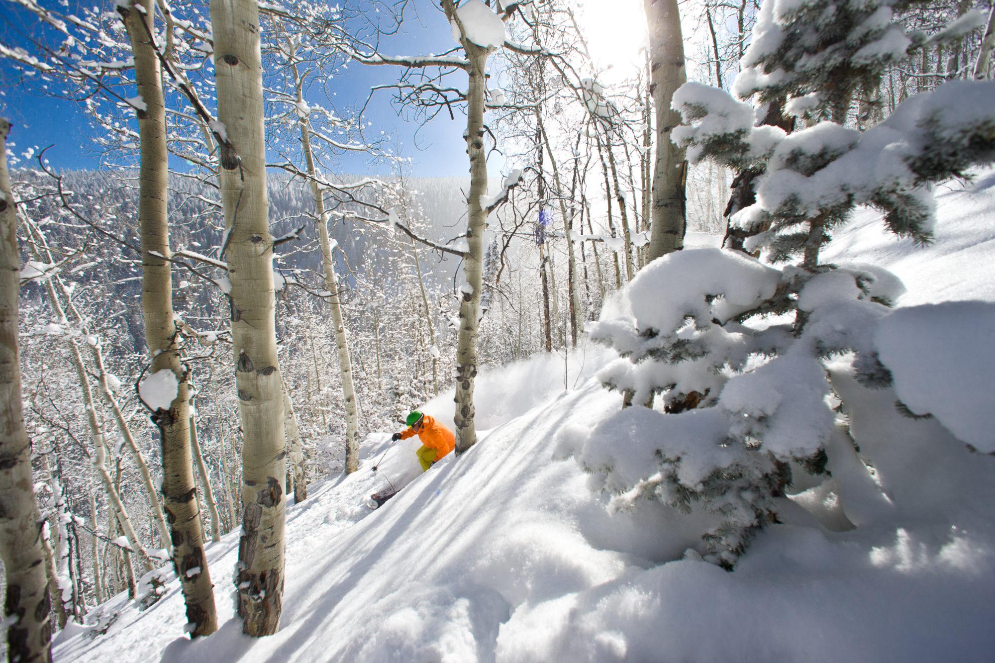 Skier in orange goes off-piste at Beaver Creek in Colorado
