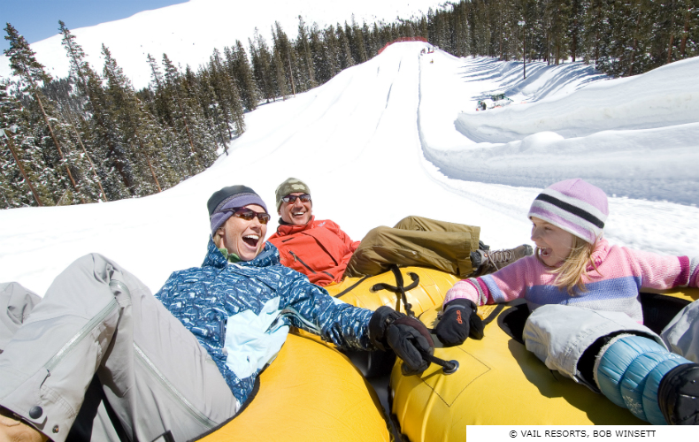 Family going snow-tubing at Adventure Point, Keystone Ski Resort in Colorado